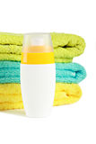 Sun lotion with towels Stock Photos
