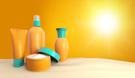 Sun lotions in the sand Stock Photo
