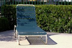 Sun lounger. Or chair with hedge in background Royalty Free Stock Images