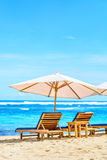 Sun lounger on the beach Stock Images
