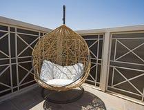 Sun lounger egg chair on terrace area royalty free stock photos