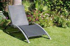 Sun lounger. A sun lounger in a garden royalty free stock photography