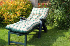 Sun lounger in a garden Royalty Free Stock Photography