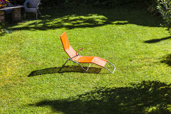 Sun lounger in the garden Royalty Free Stock Photos