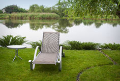 Sun lounger on the lake Royalty Free Stock Images