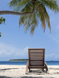 Sun lounger by the ocean Stock Photos