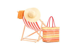 Sun lounger with orange stripes and summer accessories Royalty Free Stock Photo