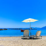 Sun Lounger and Parasol on a Beach Stock Image