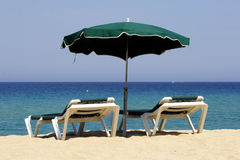 Sun lounger on sandy beach, co Royalty Free Stock Image