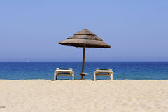 Sun lounger on sandy beach, co Stock Images