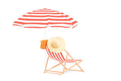 Sun lounger with stripes and umbrella Royalty Free Stock Photo