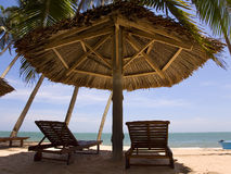 Sun loungeres and  Umbrellas against  blue sea at sun day Mui Ne Royalty Free Stock Photography