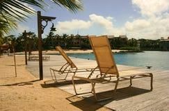 Sun loungers. 2 empty sun loungers in barbados stock photos