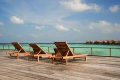 Sun loungers. At Nika Resort royalty free stock photo