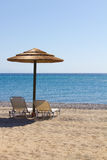 Sun loungers. Two lonely sun loungers on the beach royalty free stock photos