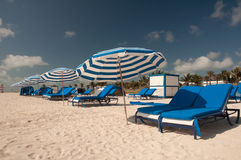 Sun loungers on beach Stock Photo