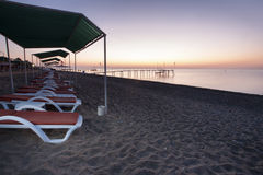 Sun loungers on the beach stock photography