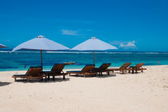 Sun loungers on the beach. Royalty Free Stock Images