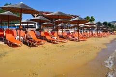 Beach in Kavala, Greece. Sun loungers on the beach in Kavala, Greece Royalty Free Stock Photos