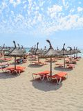 Sun loungers on the beach of Mallorca. El Arenal royalty free stock photography