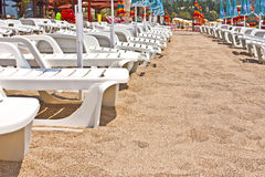 Sun loungers on the beach in Montenegro. Sun beds and sun loungers on the beach in Montenegro Budva royalty free stock photo