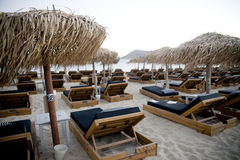 Sun loungers. In a beach in mykonos royalty free stock photo