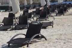 Sun loungers on the beach Stock Image