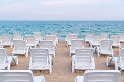 Sun loungers on the beach. Royalty Free Stock Photography
