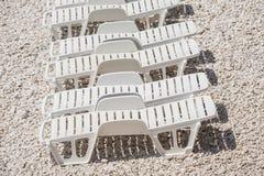 Sun loungers on the beach. Stock Photos