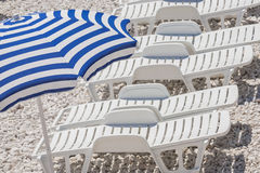 Sun loungers on the beach. royalty free stock image