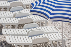 Sun loungers on the beach. Stock Photo