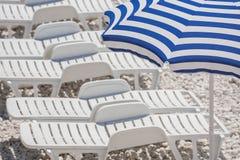 Sun loungers on the beach. stock photo
