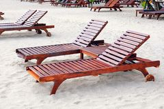 Sun loungers on beach. At sea resort royalty free stock image
