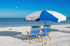 Sun loungers and a beach umbrella Royalty Free Stock Image