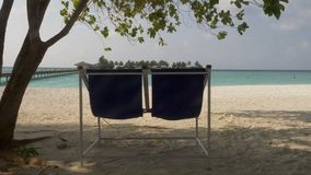 Sun loungers on the beautiful tropical beach. Maldives. 4k stock video footage