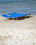 Sun loungers or beds on sandy beach. In summer royalty free stock images