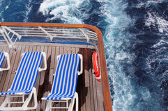 Sun loungers on cruise ship. Aerial view of striped sun loungers on rear of cruise ship on ocean Royalty Free Stock Photos