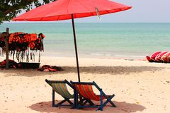 Sun loungers are on a deserted beach. life jackets are piled up stock photos