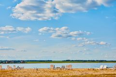 Sun loungers on the deserted river beach. Place of rest in Russia stock photo
