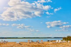 Sun loungers on the deserted river beach. Place of rest in Russia stock images