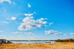 Sun loungers on the deserted river beach. Place of rest in Russia royalty free stock photo