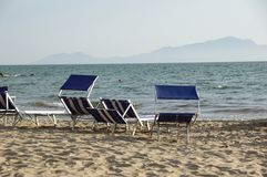 Sun loungers empty at seaside resort , the calm and relaxed atmosphere of the summer holiday at sunset.  stock photography