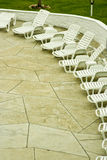Sun loungers on hotel patio. Details of vacant sun loungers on hotel sun terrace Stock Photography