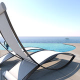 Sun loungers inviting to relaxation and rest. Stock Photo