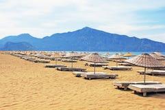 Sun loungers on Iztuzu beach. In Turkey royalty free stock images