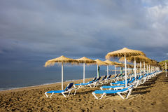 Sun Loungers at Marbella Beach Royalty Free Stock Images
