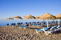Sun Loungers on Marbella Beach. Sun loungers on a beach in Marbella, Spain, Costa del Sol, Andalusia region, Malaga province stock photography