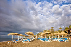 Sun Loungers on Marbella Beach Stock Images