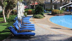 Sun loungers next to the pool at a luxury resort Stock Images