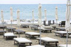 Sun loungers out of season. Empty sun loungers on the beach out of season royalty free stock photo